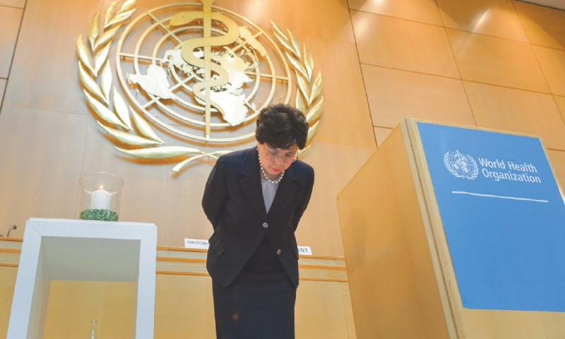 Geneva: World Health Organisation Director-General Margaret Chan greets the audience under the logo of the specialised agency of the United Nations after she addressed the WHO general assembly on Monday.—AFP