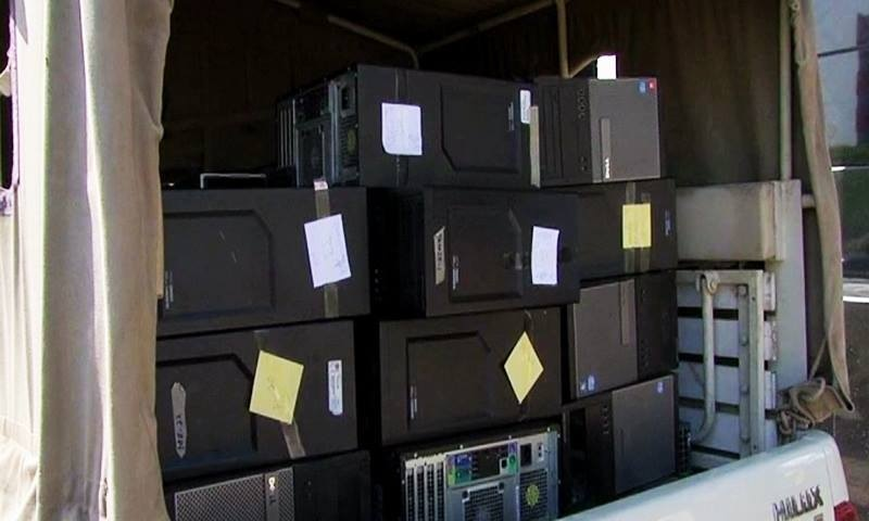 A view of the computers confiscated by the FIA team from Axact's Islamabad Office on Tuesday. — DawnNews screengrab
