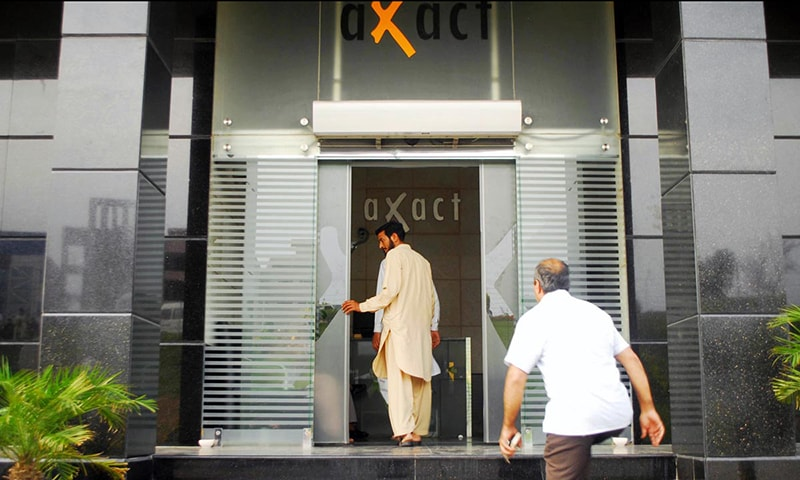 FIA officials seen during a raid on office of Axact. — Online