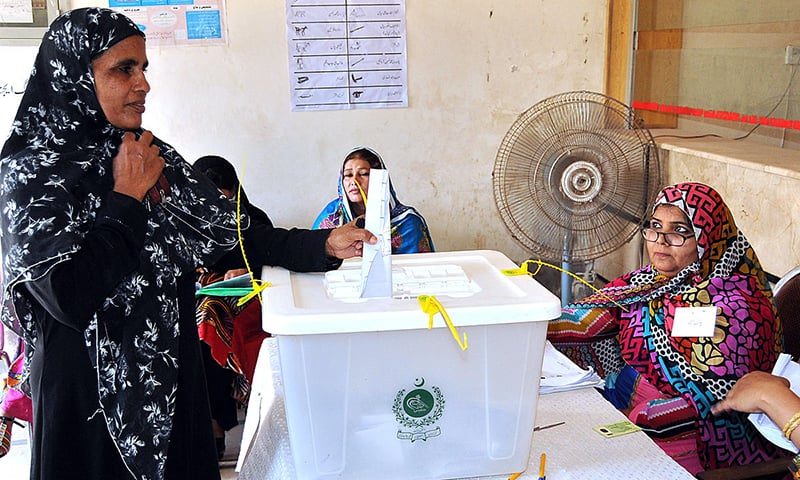 A lady casts her vote in polling station at Timber Market during by-election in the constituency PP-196. - APP