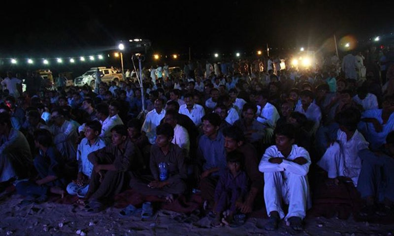 People of Thar sit on the sand as they listen to the band playing different sufi songs. — Photo courtesy: The Sketches' Facebook Page