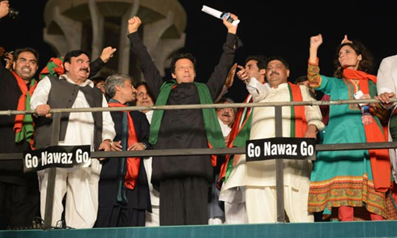 A victorious Imran atop his container