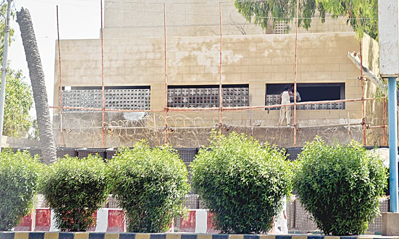 Labourers affixing prefabricated concrete windows to an under-construction structure on the premises of the historical building of Jinnah Courts, the temporary headquarters of Pakistan Rangers.—Fahim Siddiqi / White Star