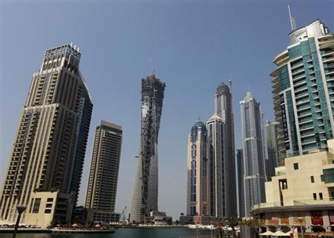 Real estate property under construction is seen near the Dubai Marina in this file photo.—Reuters