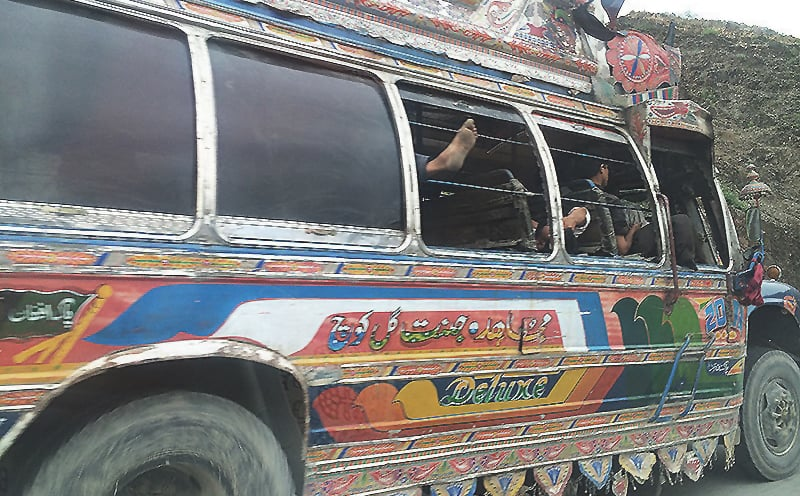 A bus carries sleepy passengers back to Peshawar city.
