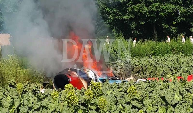 A view of the PAF trainer jet which was destroyed after it crashed in Khyber Pakhtunkhwa's Swabi district.  — DawnNews screengrab