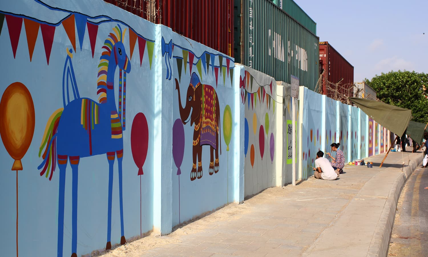 Walls painted at MT Khan road by artists