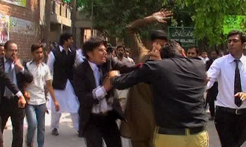 A lawyer and policeman clash during protests — DawnNews screengrab