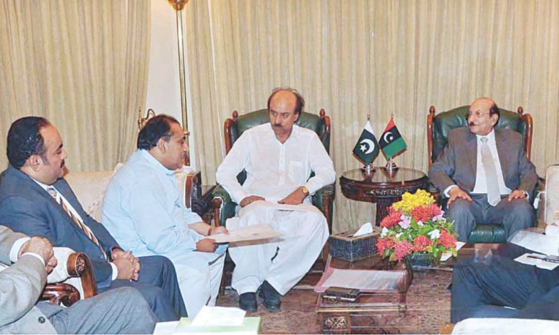 DELEGATES of the Muttahida Qaumi Movement discuss the water shortage issue in the city with Sindh Chief Minister Syed Qaim Ali Shah and his cabinet members at CM House on Monday.—APP