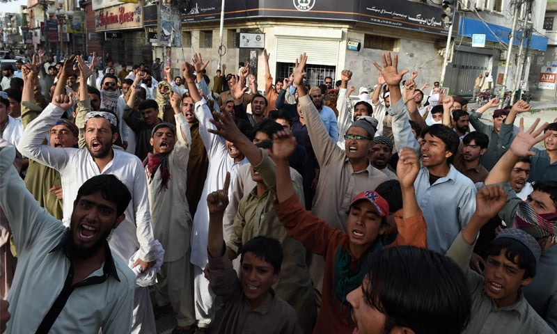 QUETTA: People protest against a firing incident in a market here on Monday. Four people, including three members of the Hazara community, were killed and eight others, including two women, suffered bullet injuries in different sectarian incidents in the city.—AFP