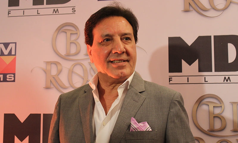Javed Sheikh arrives at the press conference.— Photo by Zoya Anwer