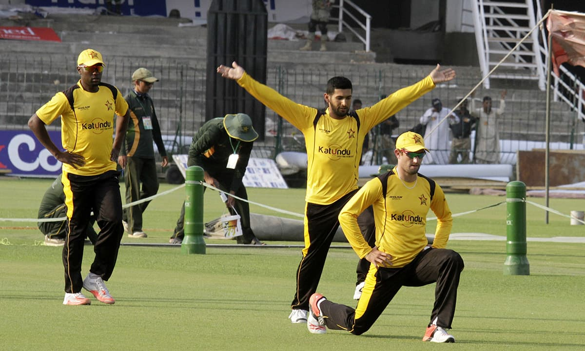 Zimbabwe players take part in a net practice at the Gaddafi stadium in Lahore. — AP