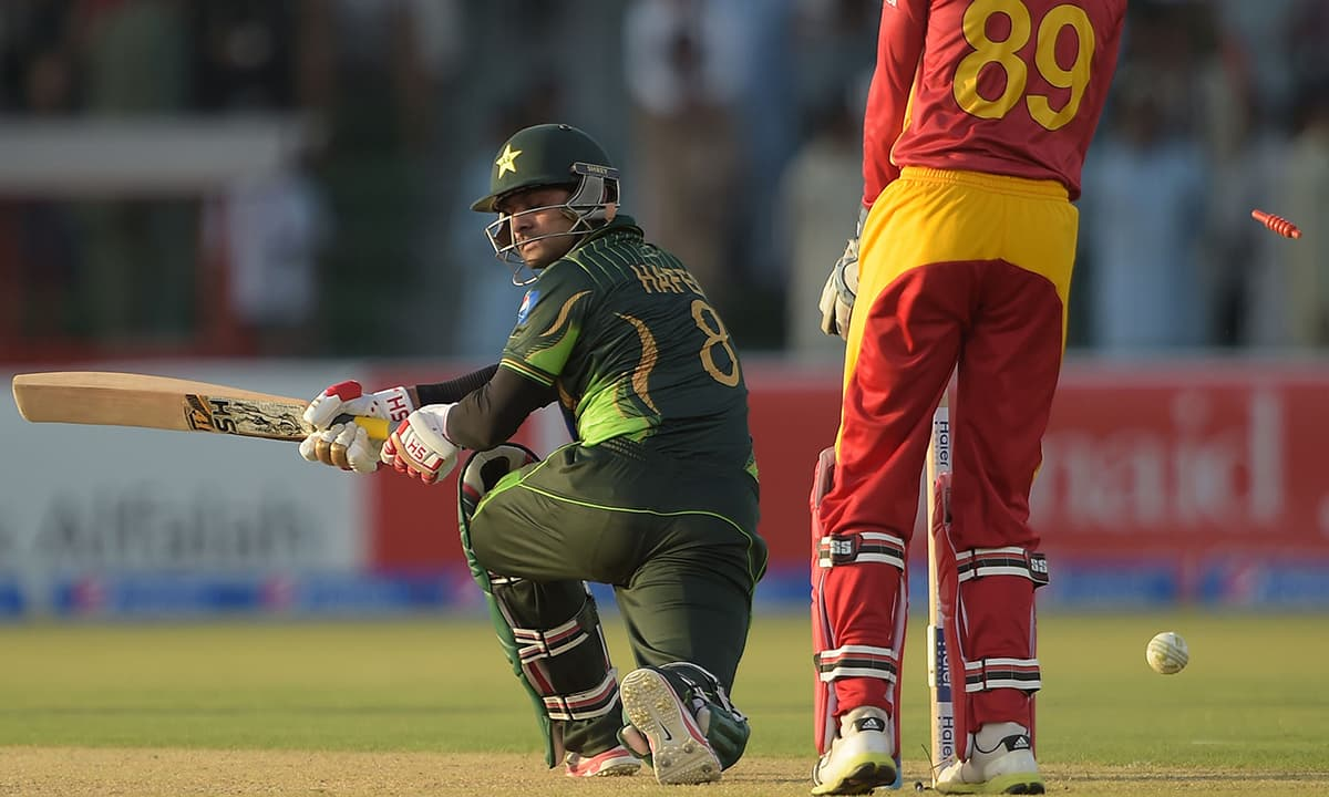 Mohammad Hafeez is bowled out by unseen Zimbabwean spinner Prosper Utseya during the first ODI between Pakistan and Zimbabwe at the Gaddafi Stadium in Lahore. — AFP