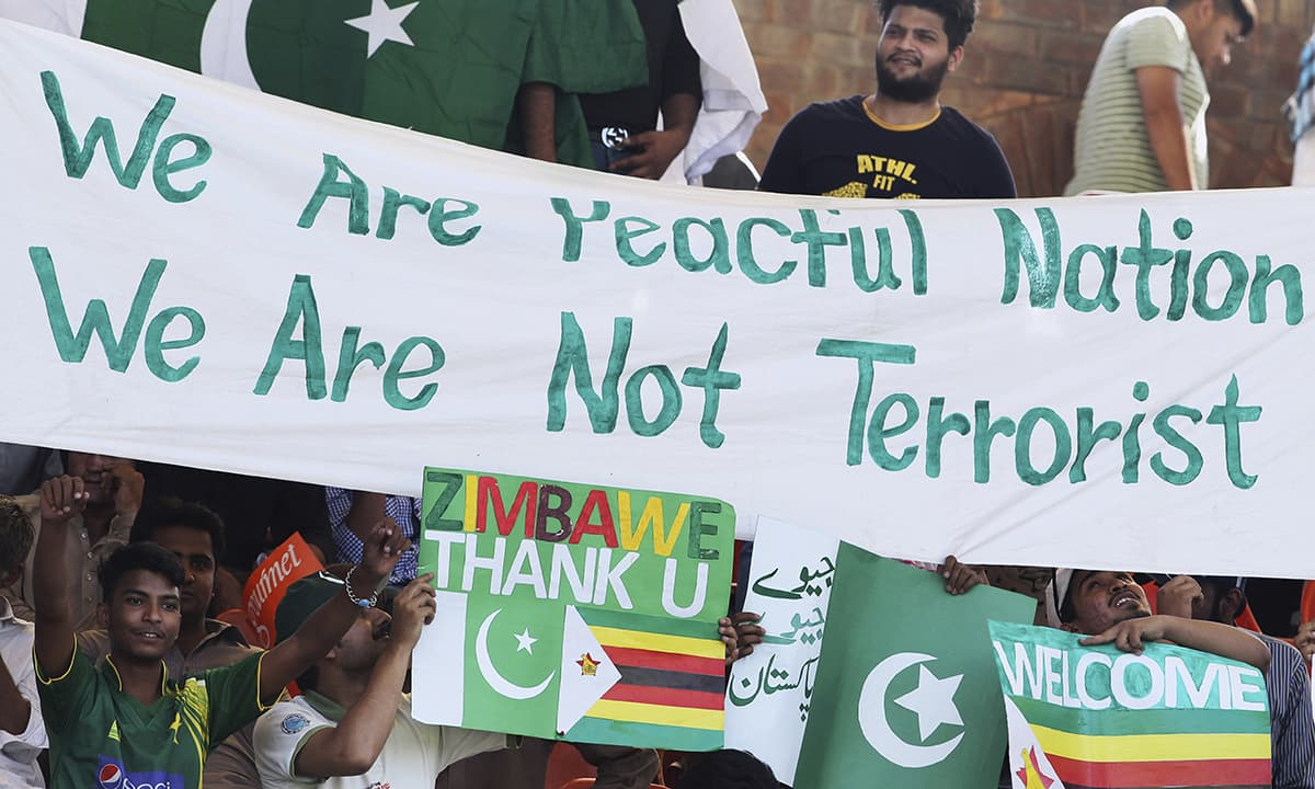 Fans cheer during the first ODI between Pakistan and Zimbabwe at Gaddafi Stadium in Lahore. — AP
