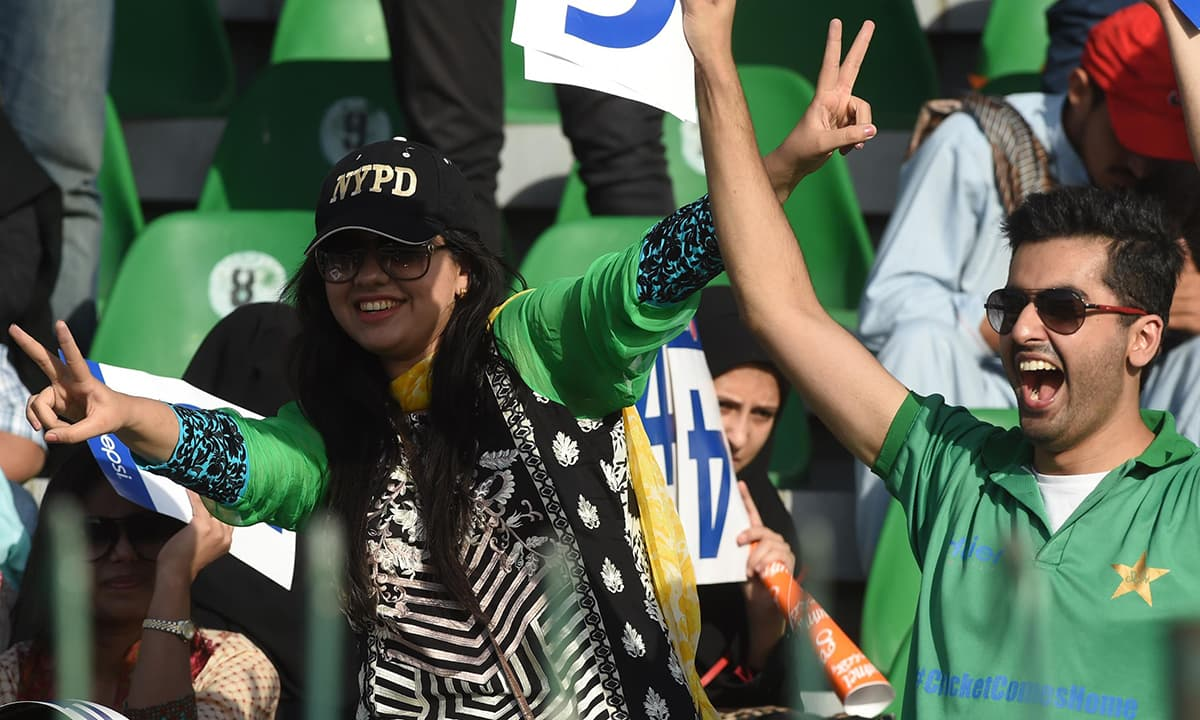 Spectators enjoy the first ODI between Pakistan and Zimbabwe at the Gaddafi Stadium in Lahore. — AFP