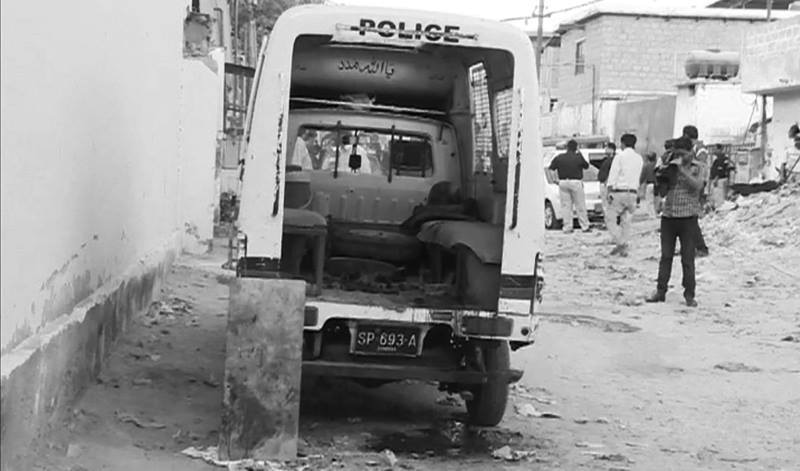 A view of the police van which was fired upon by unknown attackers in Karachi. — DawnNews screengrab
