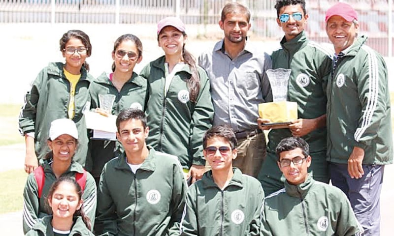 Members of Sindh track and field squad pose for a group photo after their fine show.—photo by Jawwad Farid