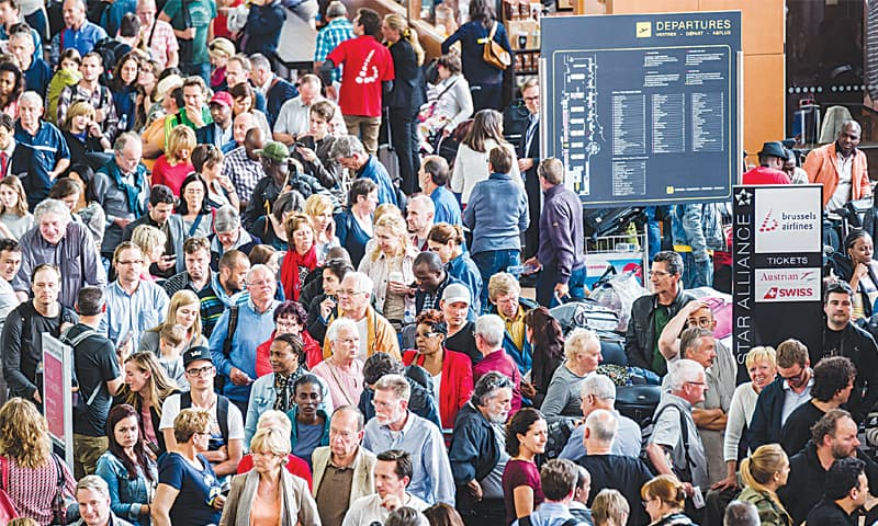 Brussels: Passengers wait at ticketing desks at Brussels airport in Zaventem on Wednesday after an electrical failure paralysed much of the air traffic in the country.—AP