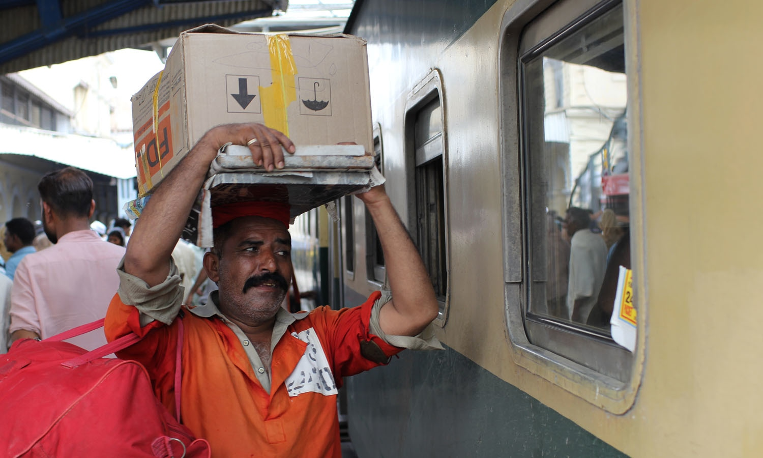 Life of a porter is not an easy one, they have to keep up with the pace of passengers and their luggage.