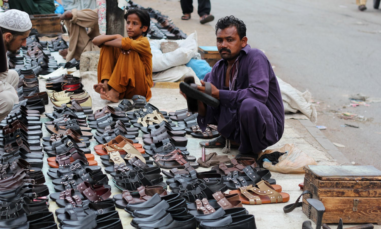 Footpaths occupied by shoe-sellers outside the Cantt Station.