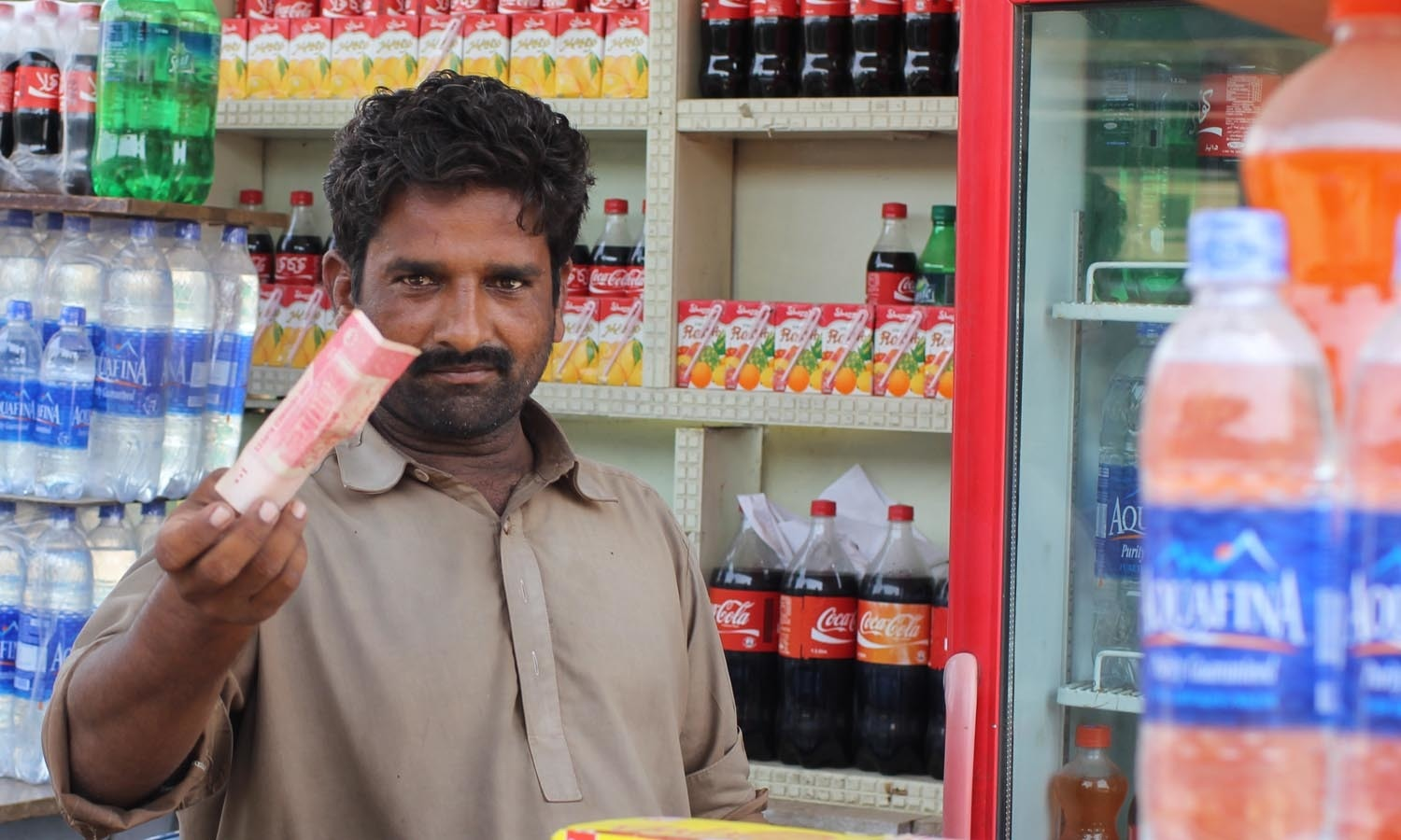 Rizwan, a dhaba owner greets us with a hundred rupee note.
