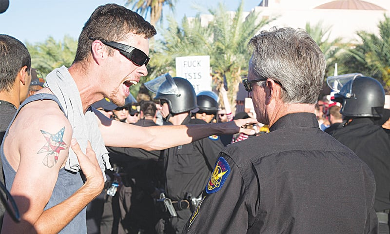 Phoenix: An anti-Islam protester shouts at police during the protest.—AFP