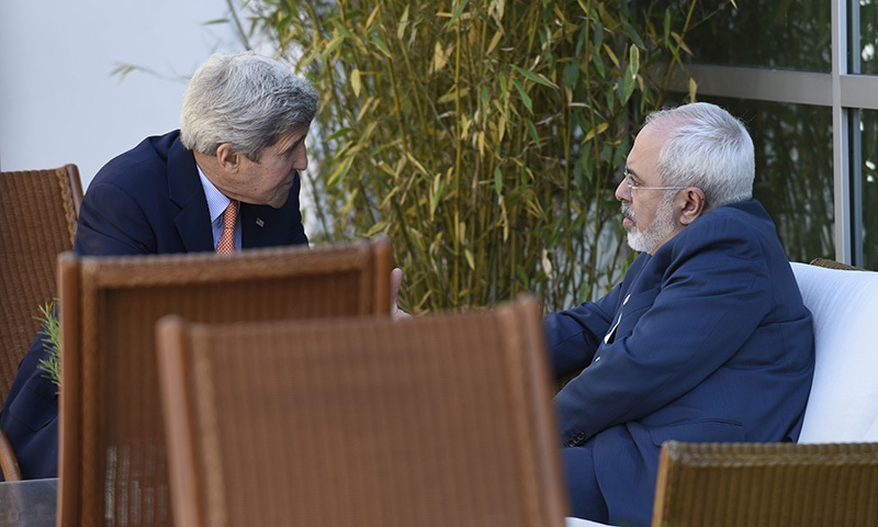 US Secretary of State John Kerry (L) talks with Iranian Foreign Minister Mohammad Javad Zarif on May 30, 2015 in Geneva. — AFP