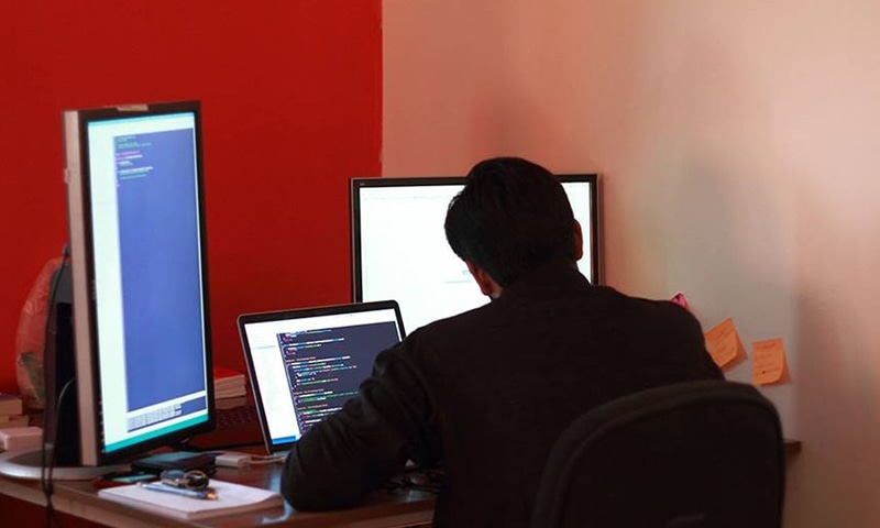 A view of a Creative Frontiers staff member working in a hip Silicon Valley-style office in Lahore — Photo Courtesy of   Mustafa Hasnain