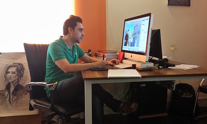 Comic book creator Yahya Ehsan working in the Creative Frontier office in Lahore — Photo Courtesy of   Mustafa Hasnain