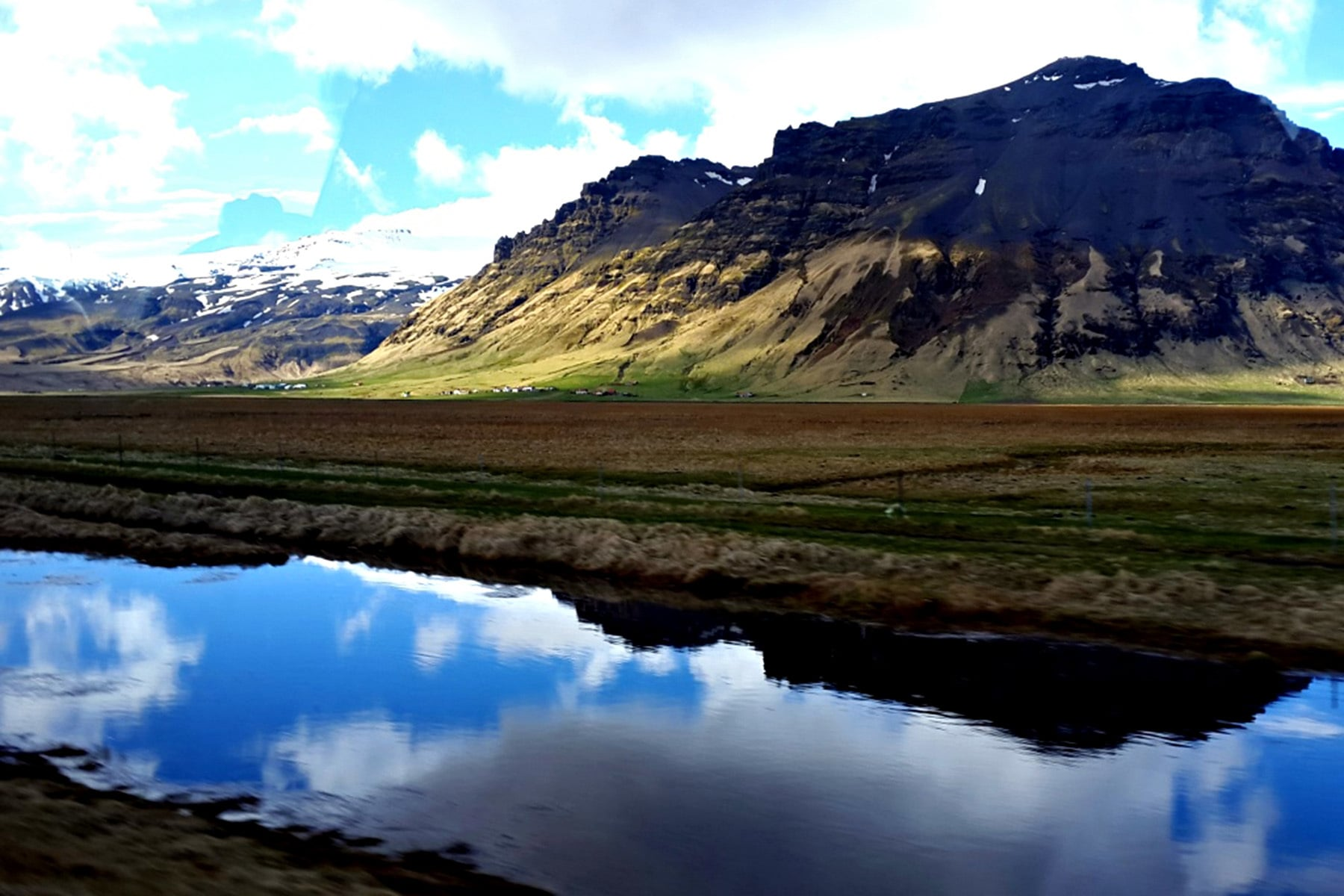 Iceland's landscape is dotted by volcanoes, glaciers, rivers, small villages and farms.