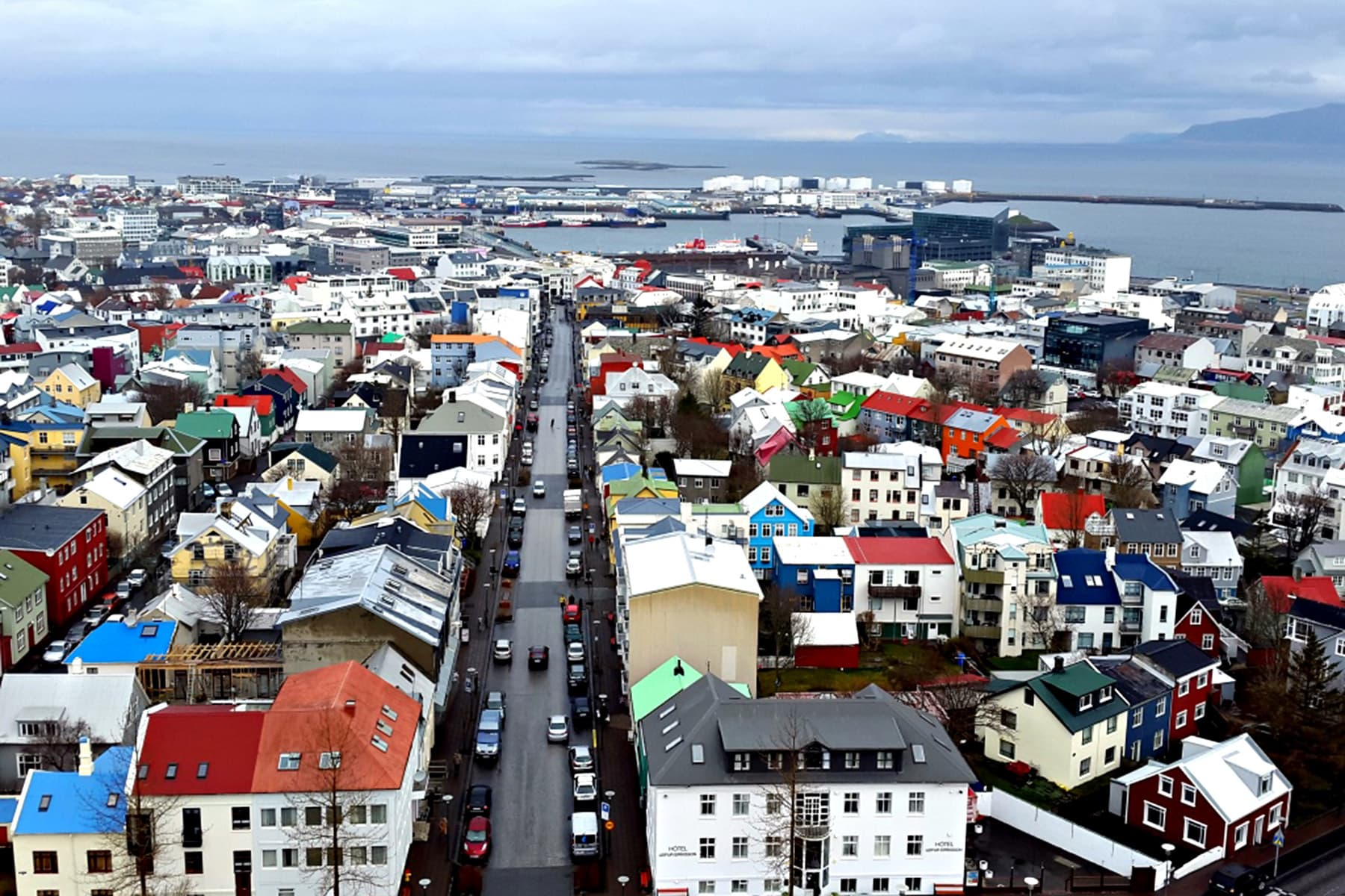View of Reykjavik from the Hallgrimskirkja Cathedral. Colourful rooftops dot the picturesque city and can be spotted from various locations given the hilly terrain.