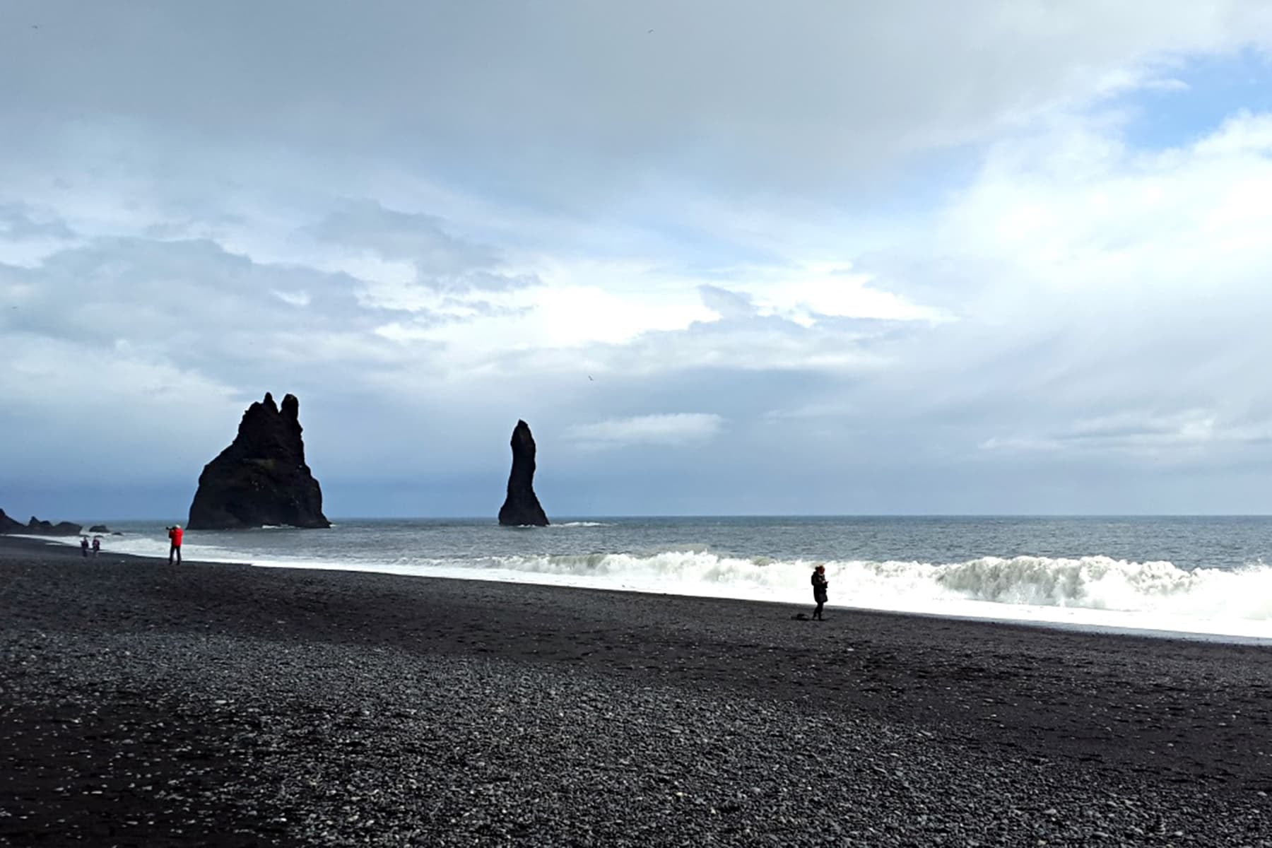 Black-sand beaches on the south coast.