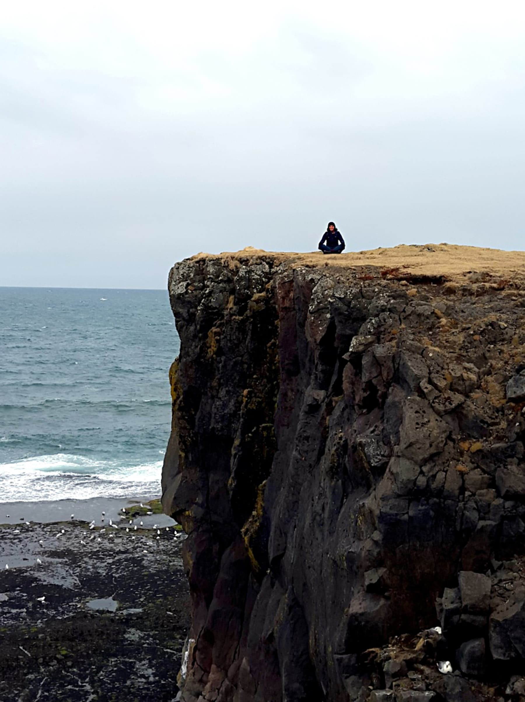 Taking a break on a cliff on the south-western coast.