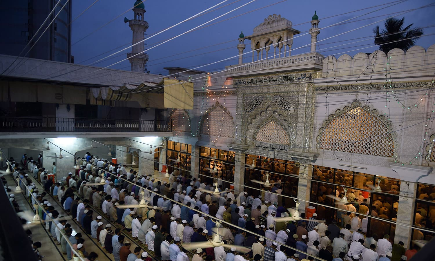 Pakistani Muslims offer prayers at a mosque to mark Shab-e-Barat. ─ AFP