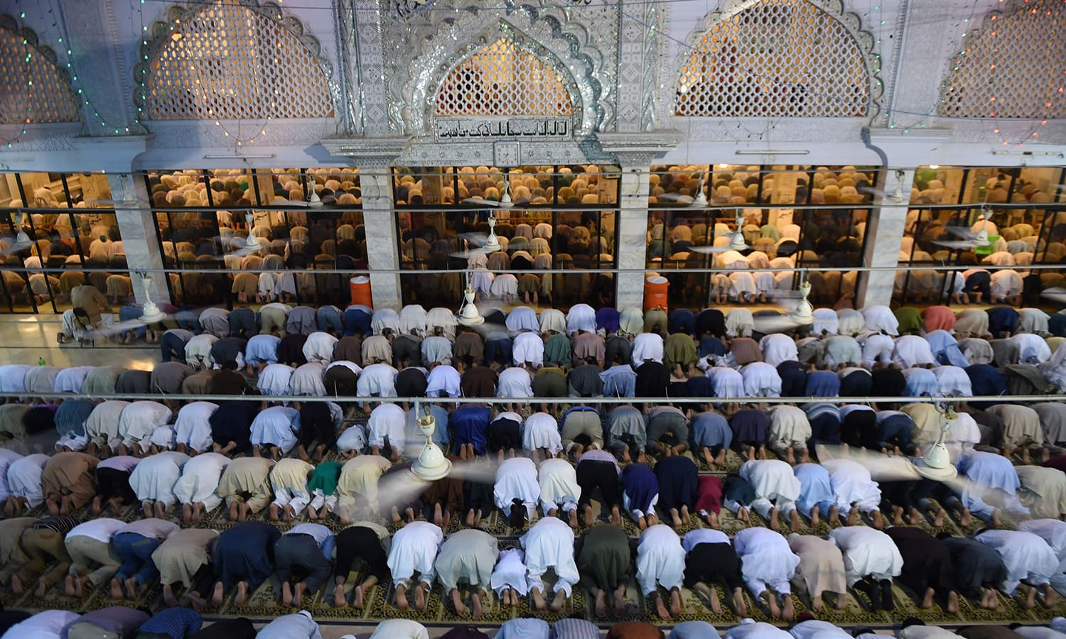 Pakistani Muslims offer special prayers at a mosque to mark Shab-e-Barat. ─ AFP