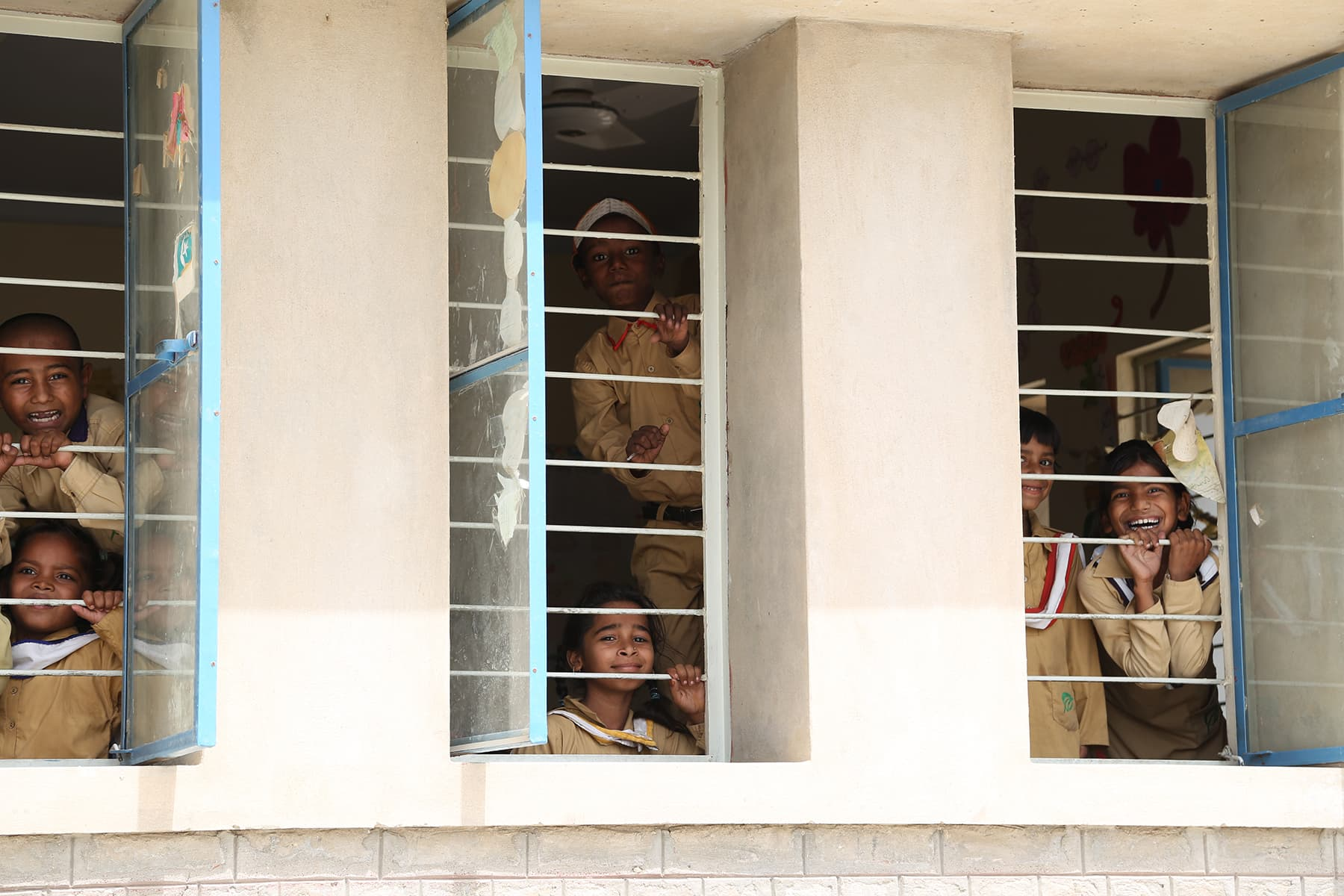 Students of the TCF Gambat school peep put of their classroom window. - Photo by Mustafa Ilyas