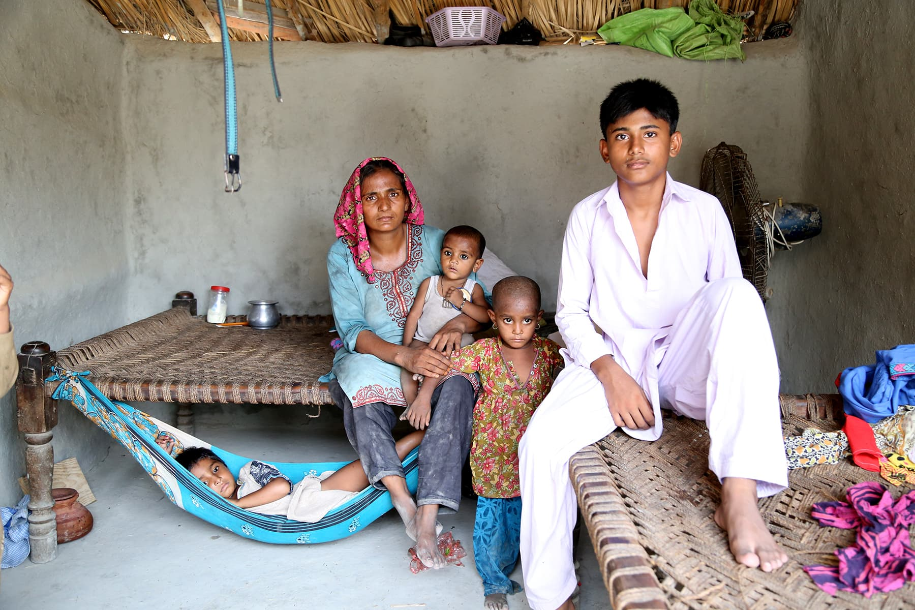 Khalil Ahmed's family pictured at their home in Gambat. - Photo by Mustafa Ilyas