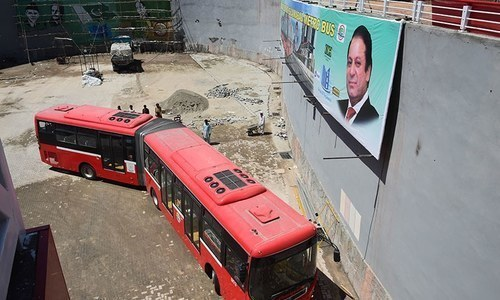 A Metrobus makes a turn at a station in Islamabad. —AFP