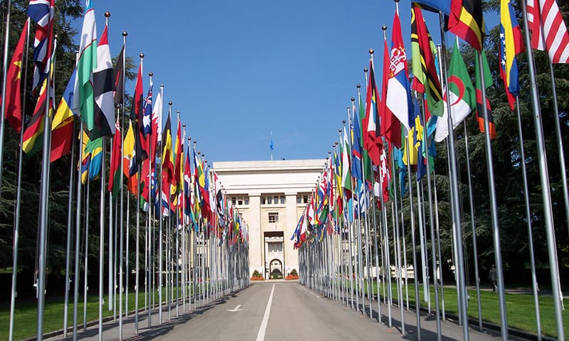 Flags outside the United Nations headquarters in Geneva | EPA