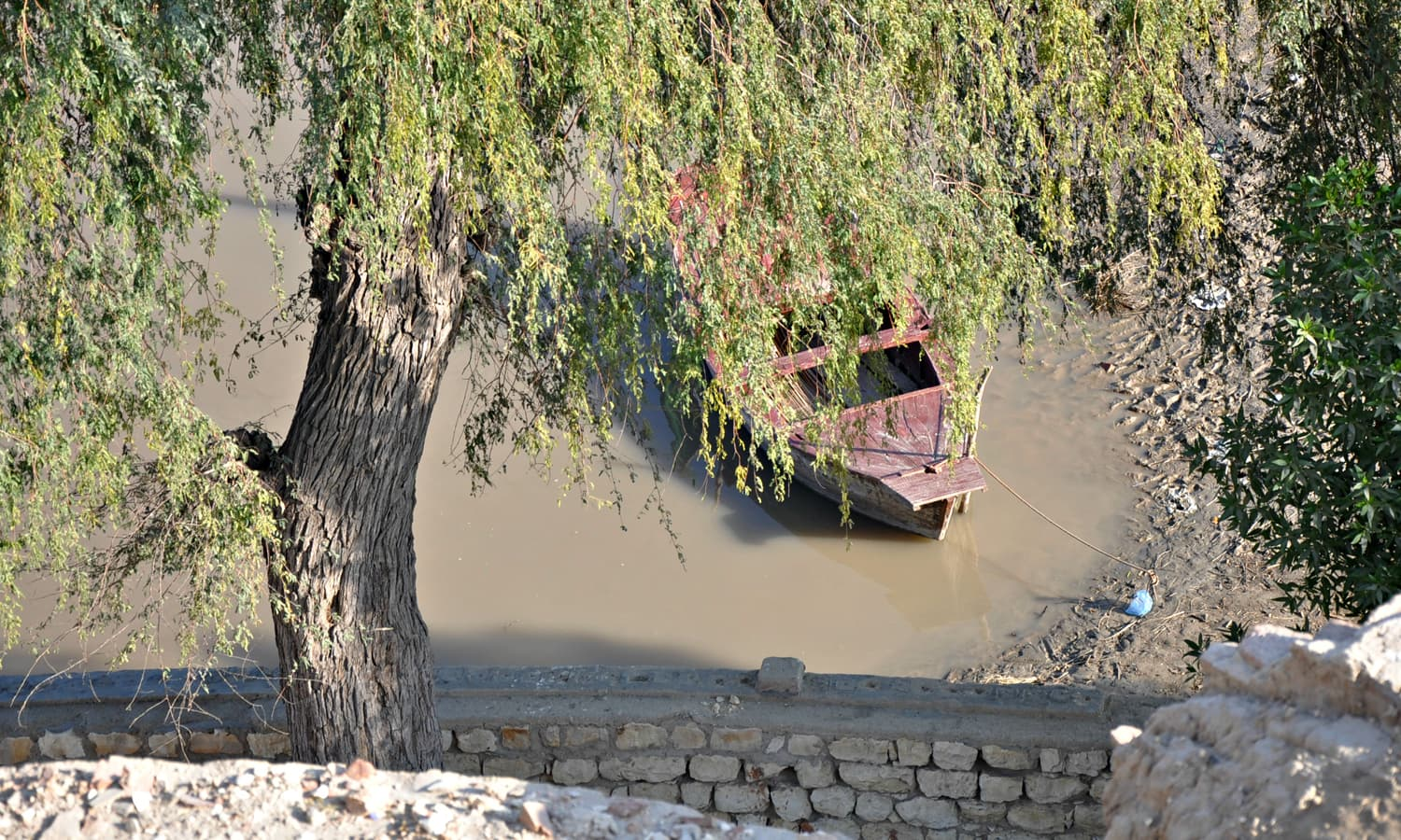 Abode of Seven - A boatman arrives  at rivers bank