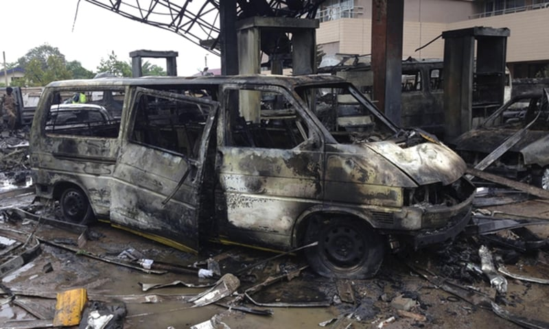 The charred wreckage of a minivan is seen at a gas station that exploded overnight killing around 90 people in Accra, Ghana. -Reuters