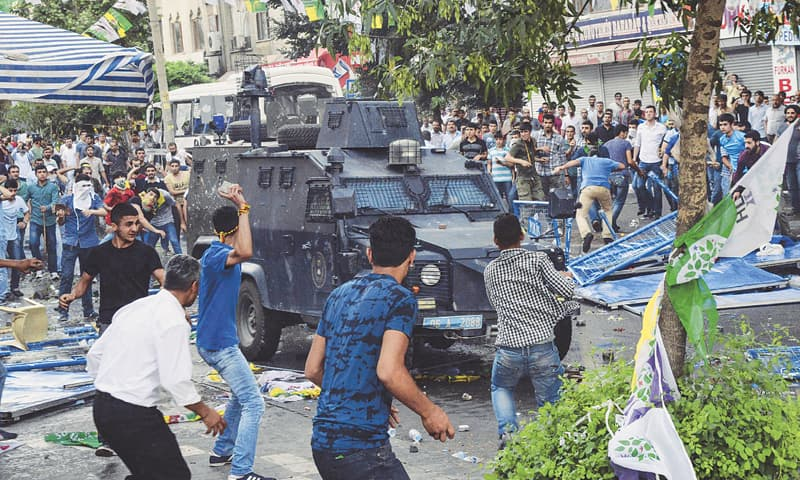 Diyarbakir: People clash with Turkish police after an explosion which killed two people during a rally by the pro-Kurdish Peoples Democratic Party on Friday.—AFP