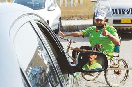 PARKED IN: Fayaz Khan gives the thumbs-up to a colleague