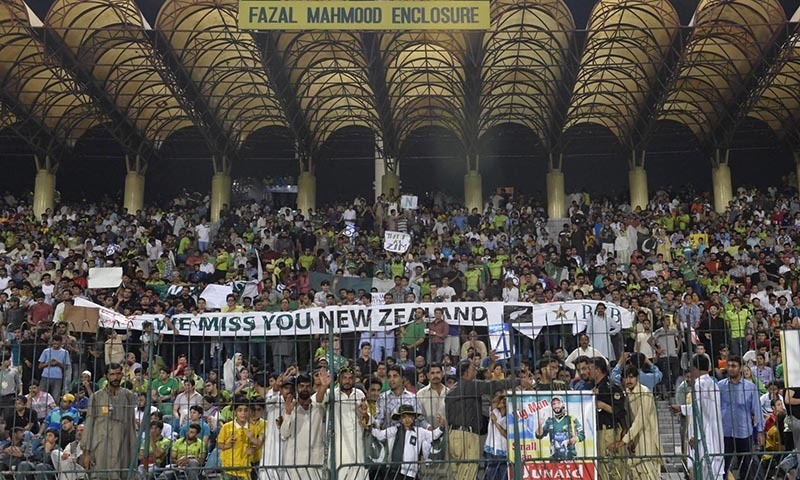 Fans at Gaddafi Stadium hold banners calling out to international cricket teams that they are missed in Pakistan | M Arif, White Star