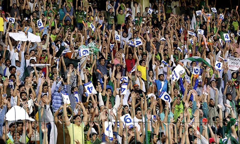 Crowds at Lahore's Gaddafi Stadium cheer at the first Pakistan versus Zimbabwe T20 match | M Arif, White Star