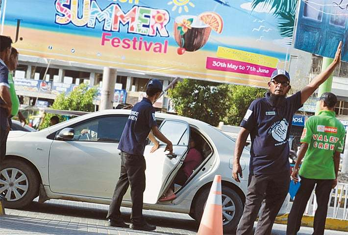 Service wardens greet customers upon their arrival to the shopping mall