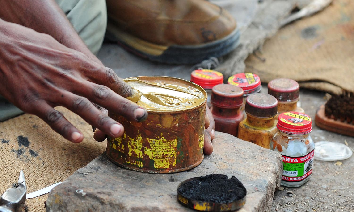 Preparing coloured shoe-polish is a task that requires precision.-AFP
