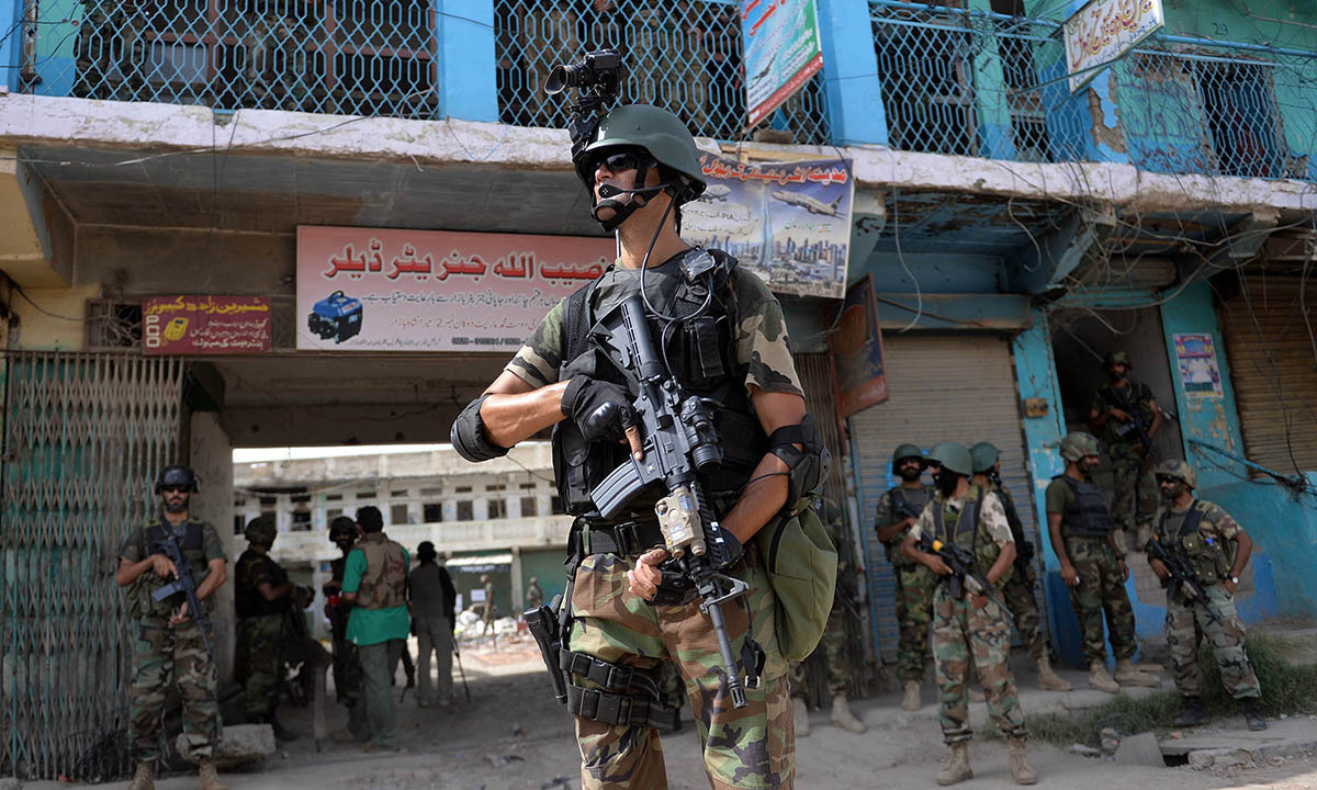 Soldiers patrol at an empty bazaar during a military operation against Taliban militants in the main town of Miramshah in North Waziristan.— AFP/file
