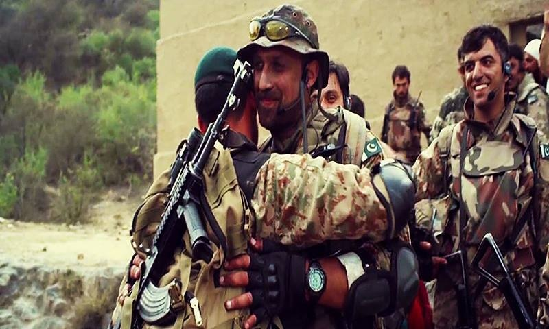 Soldiers congratulate each other on a successful mission. ─ ISPR