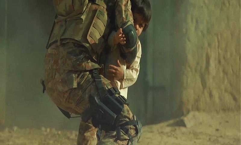 A child stranded in the middle of an exchange of fire is scooped up by a soldier. ─ ISPR